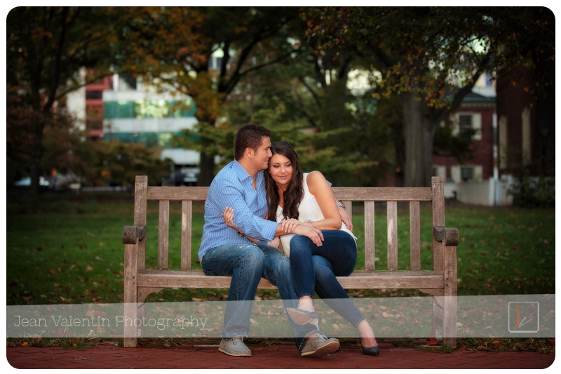 Engagement portrait. Couple sitting on a bench