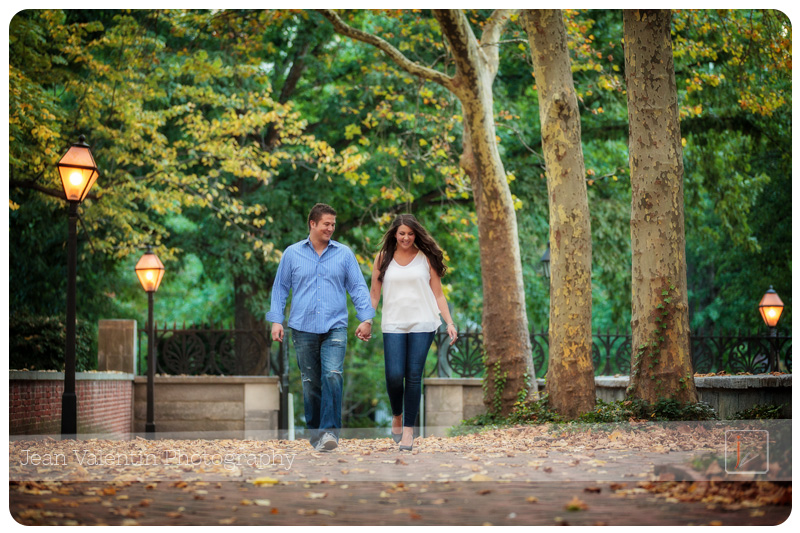 Engagement session in Old City Philadelphia at Independence National History Park. Couple walking in the park holding hands.
