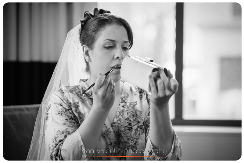bride getting ready and putting her own makeup
