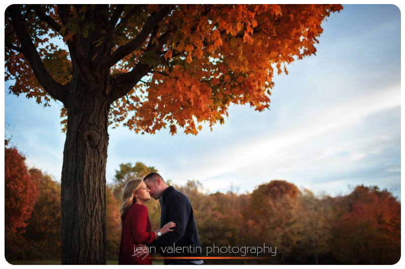 Engagement session portrait with fall foliage