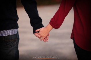 walking couple holding hands and engagement ring