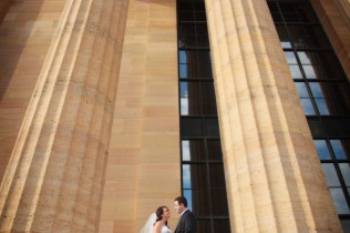 bride and groom portrait on the steps at art museum in philadelphia
