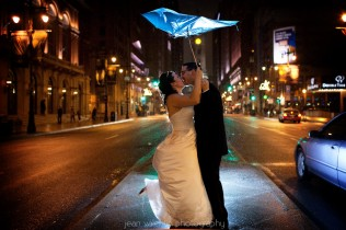 bride and groom portrait on broad street at night in philadelphia