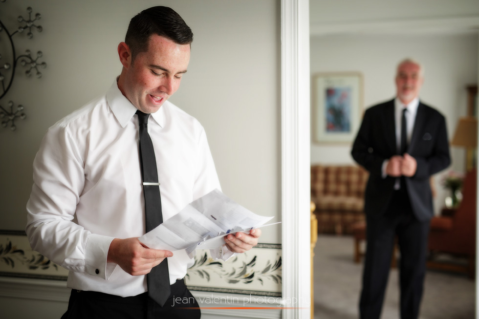 Groom reading letter from the bride