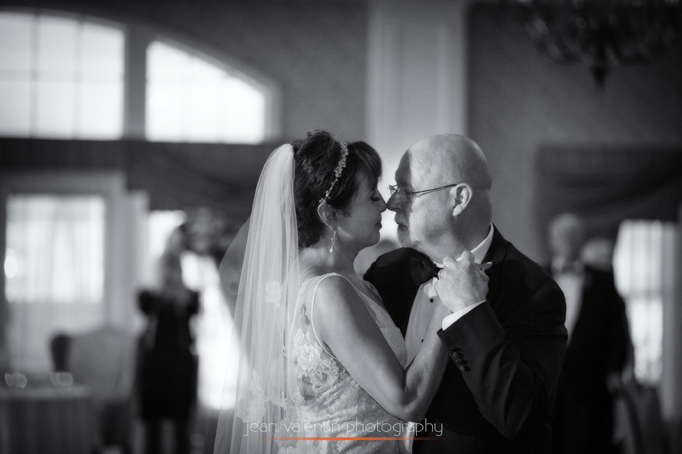 Black and white portrait of bride and groom dancing during the first dance.