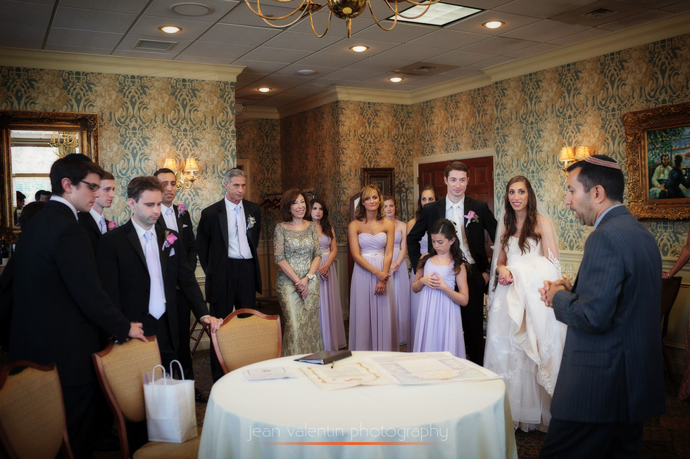 Rabi giving the last instructions before ketubah signing for a jewish wedding